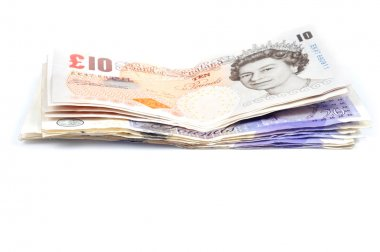 Pile of Britisch pounds on white background with
