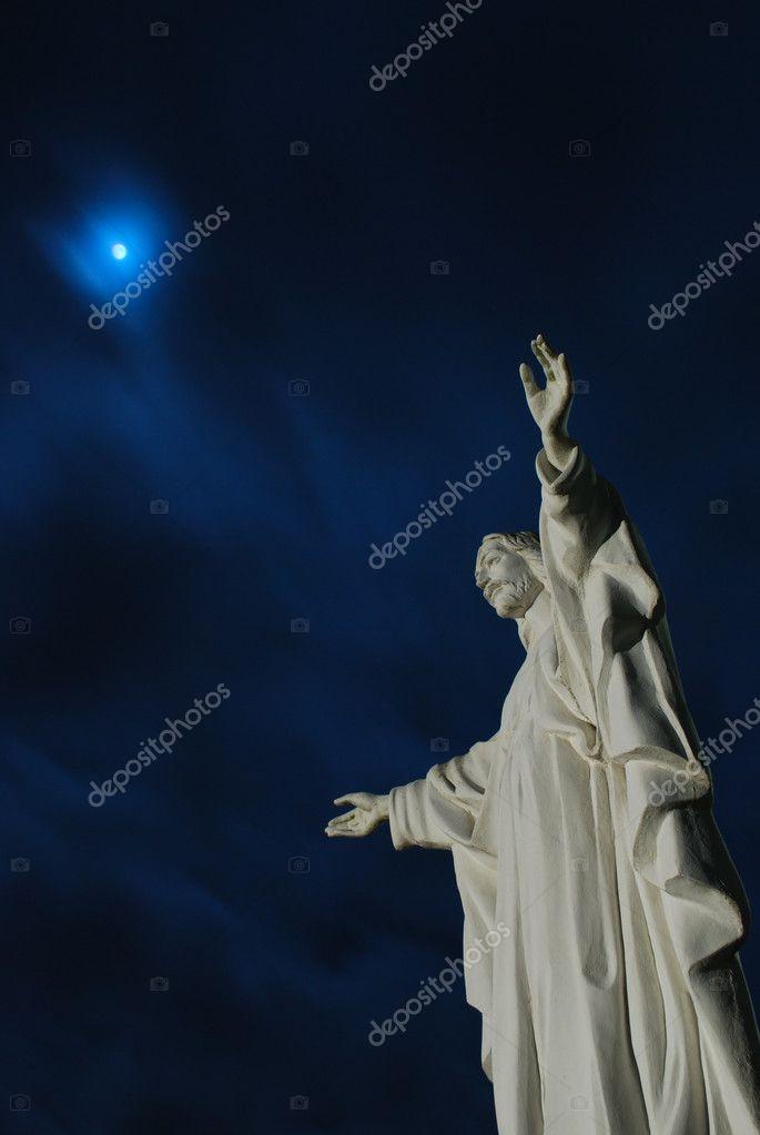 Moon beyond Jesus Christ statue
