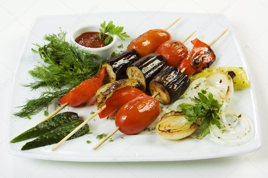 Grilled vegetables and herbs on a plate