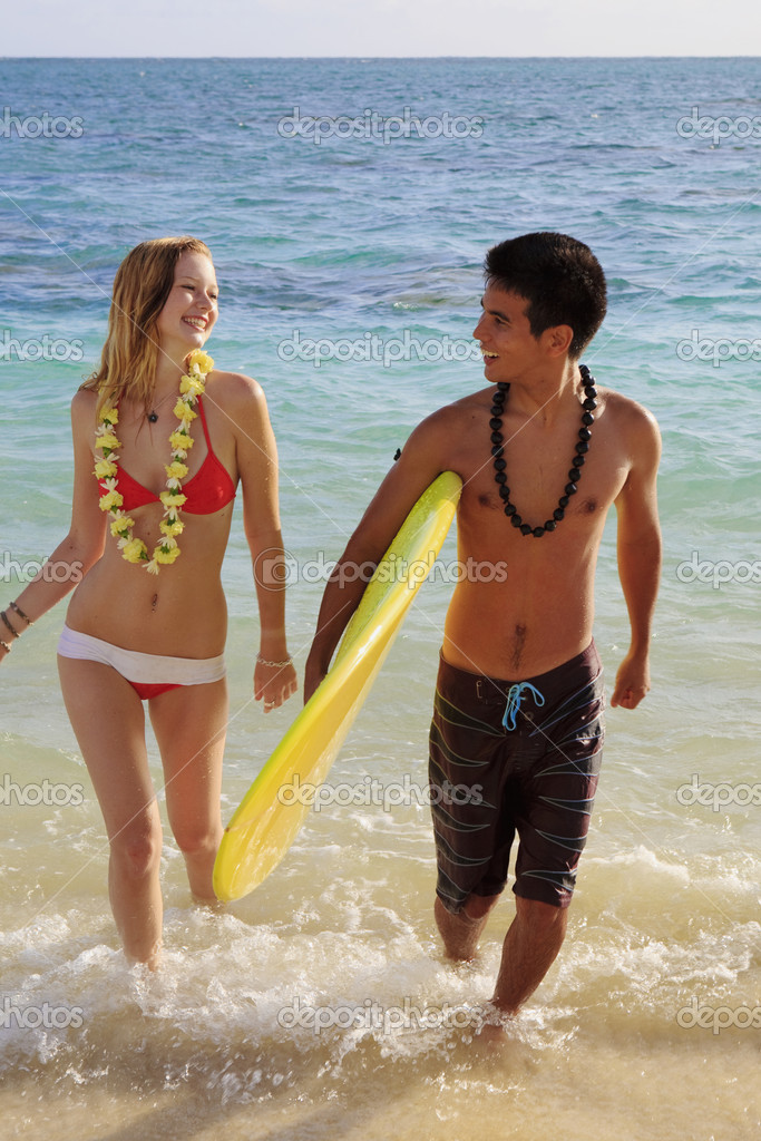 Beach boy and young blond woman