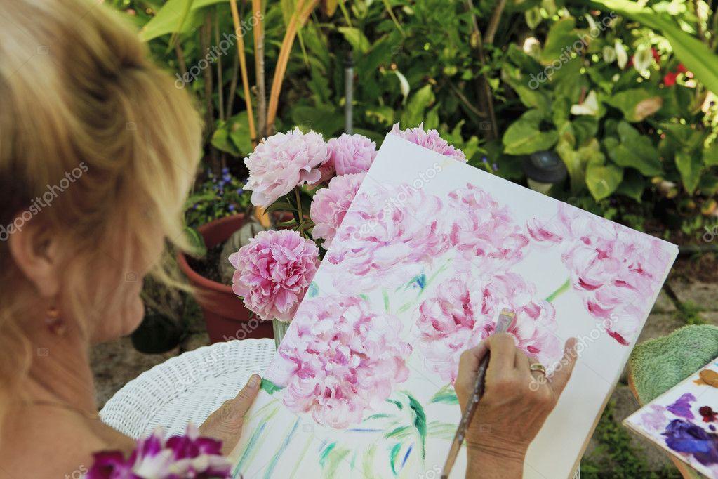Artist painting flowers