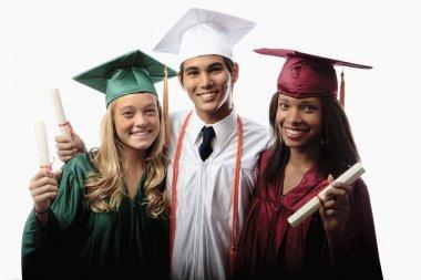 Three graduates in cap and gown