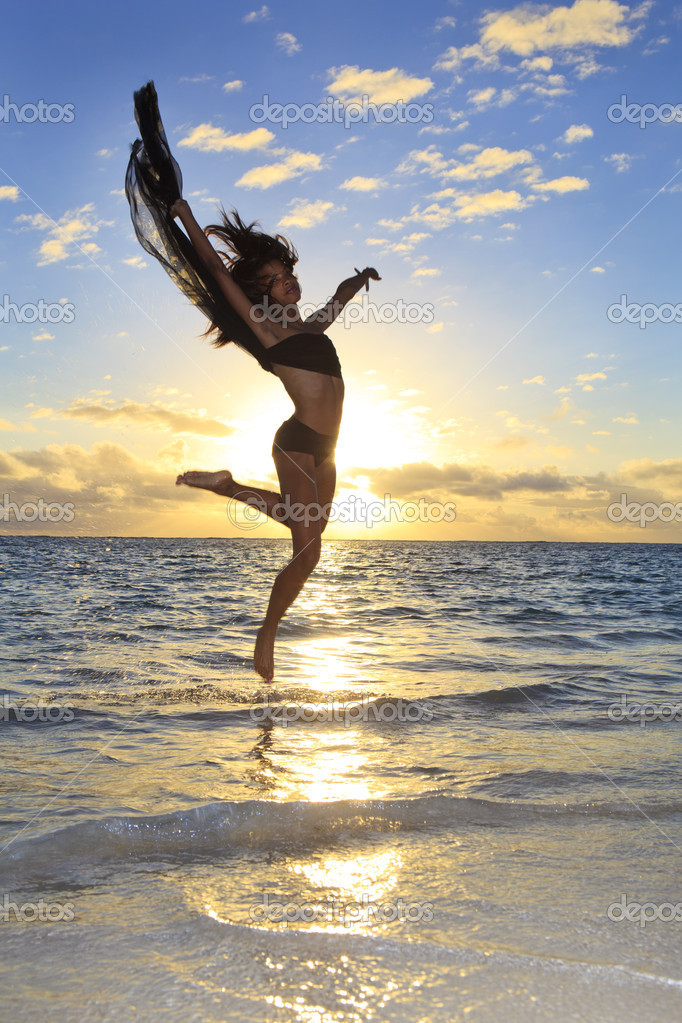 Black female dancer leaping in the air