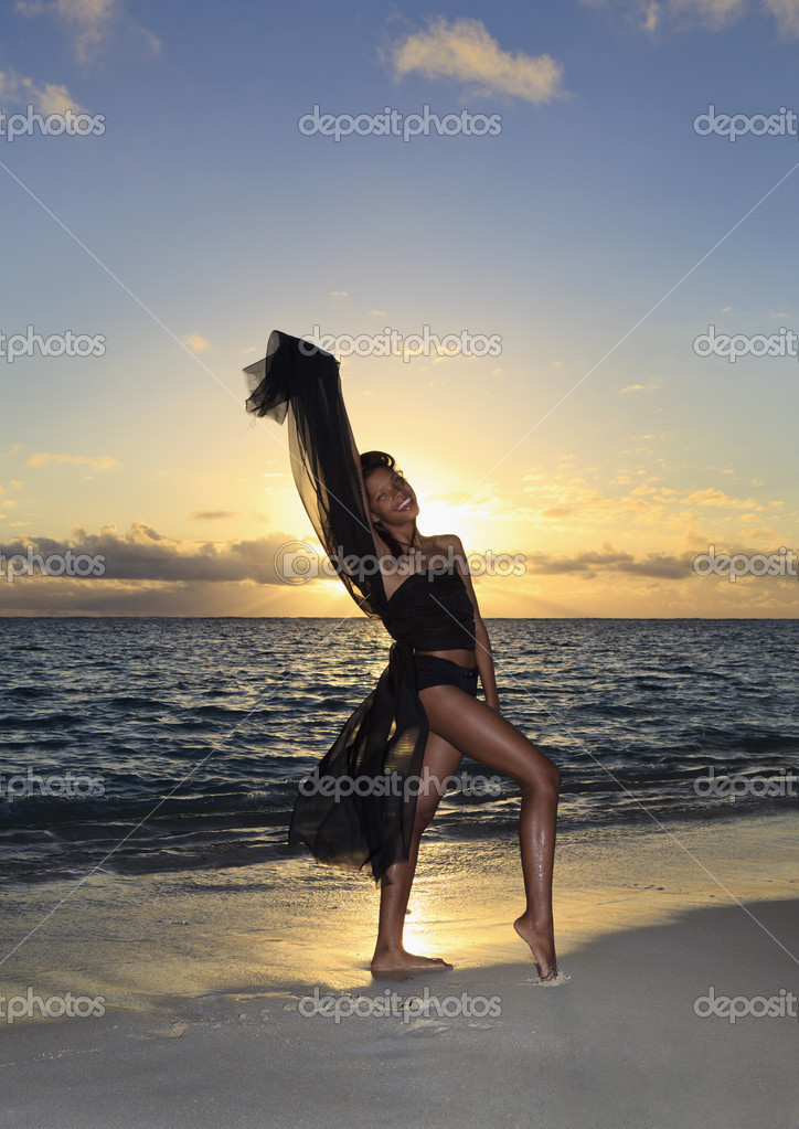 Black female dancer standing by the ocean