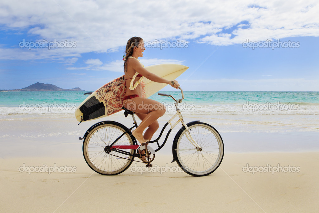 Teenage girl with surfboard and bicycle