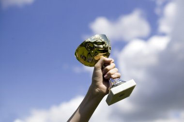 Man holding cup of winning