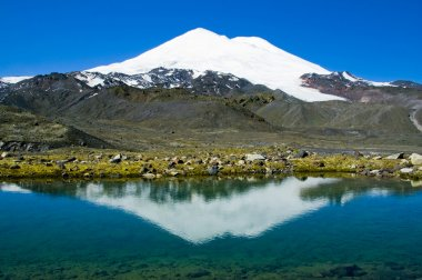 Elbrus is reflected in a mountain lake