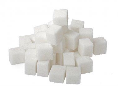 Lump sugar pile isolated on white.
