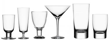 Set of empty cocktail glasses isolated on white background with
