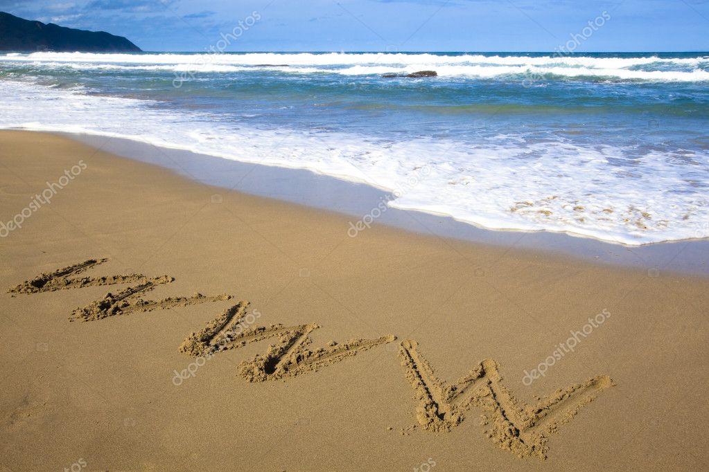 Internet symbol draw on beach
