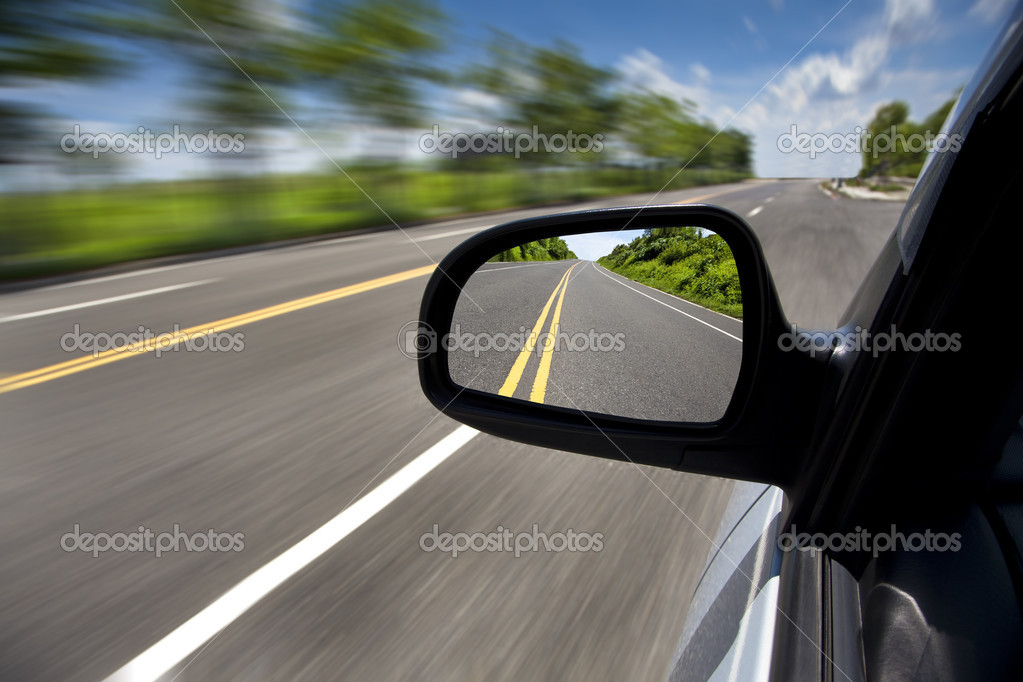 Car driving through the empty road