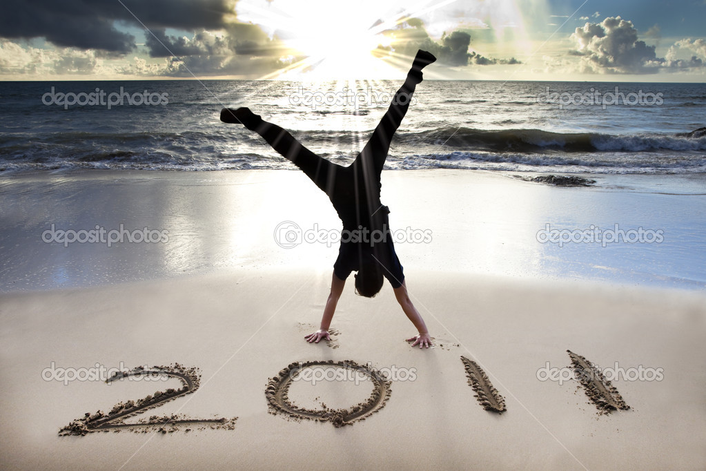 Happy new year 2011 on the beach of sunrise