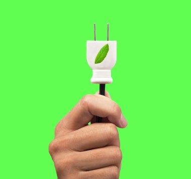 Hand holding eco power plug