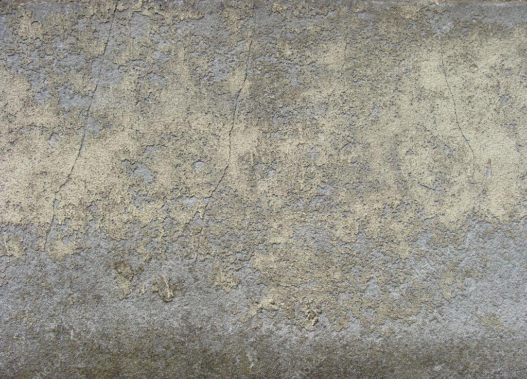 Dirty gedragen grijs blauw muur met gele verf peeling u stockfoto