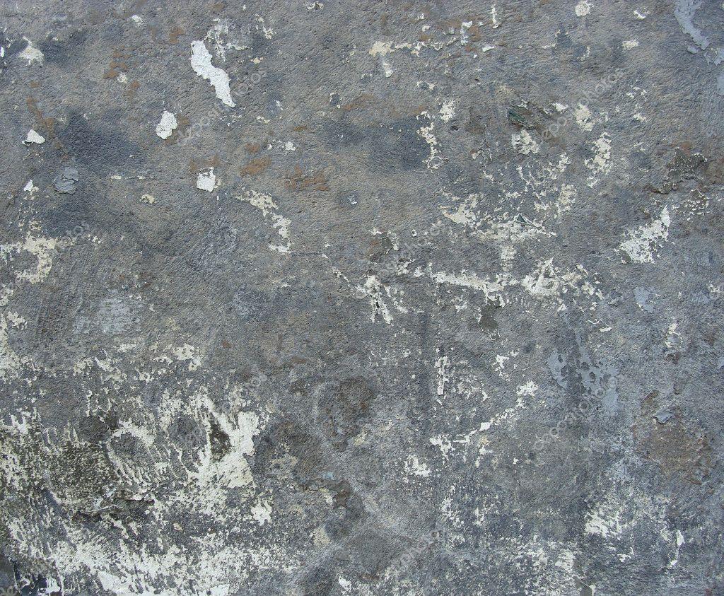 Blauw grijs vuile muur met overgebleven verf u stockfoto