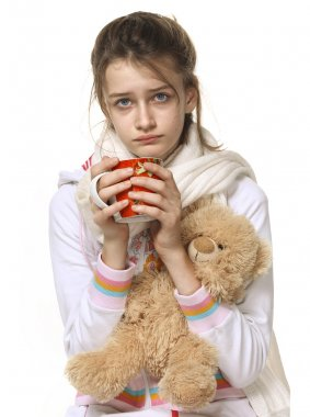 Ill girl with red cup and bear