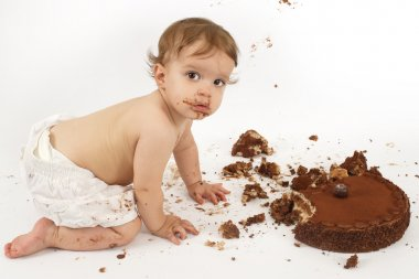 Baby eating chocolate cake