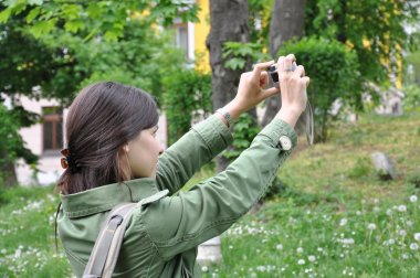 Adventure girl taking a photo in natur