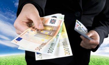 Hand giving Euro banknotes money