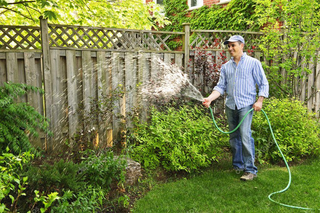 Lovely Man Watering Garden U2014 Stock Photo #4719775