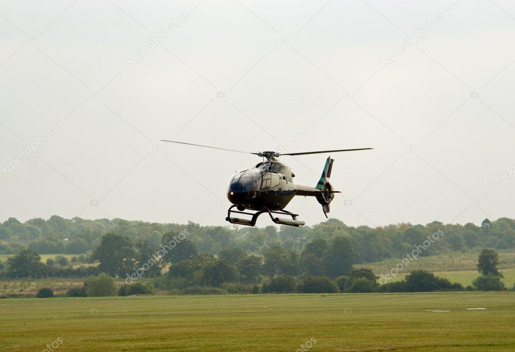 Black EC-120 hovering