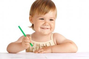 Happy child with green crayon