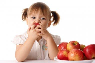 Child eats red apple