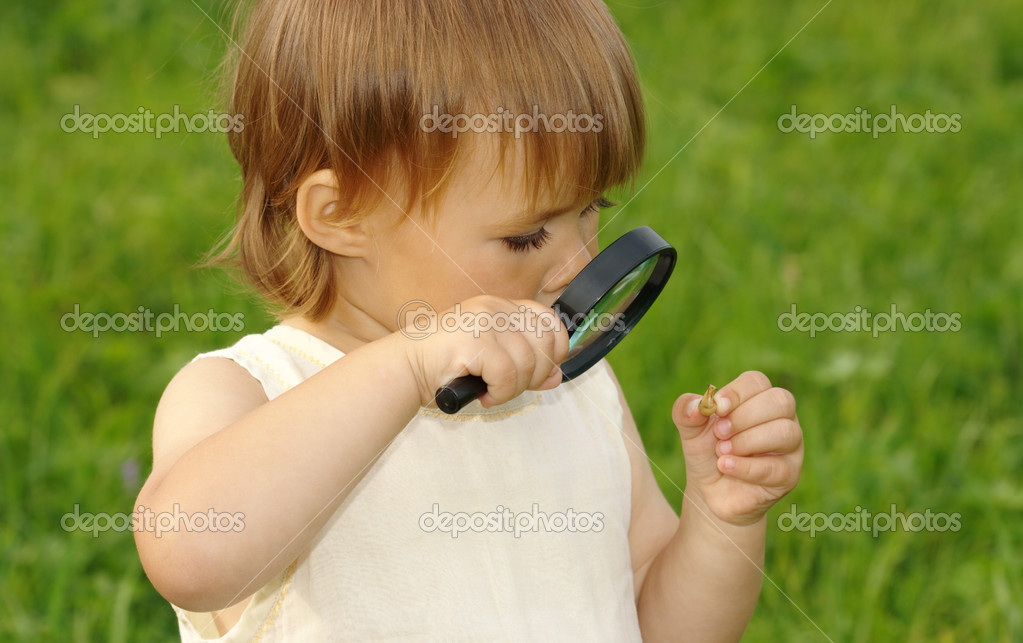 Child is looking at snail