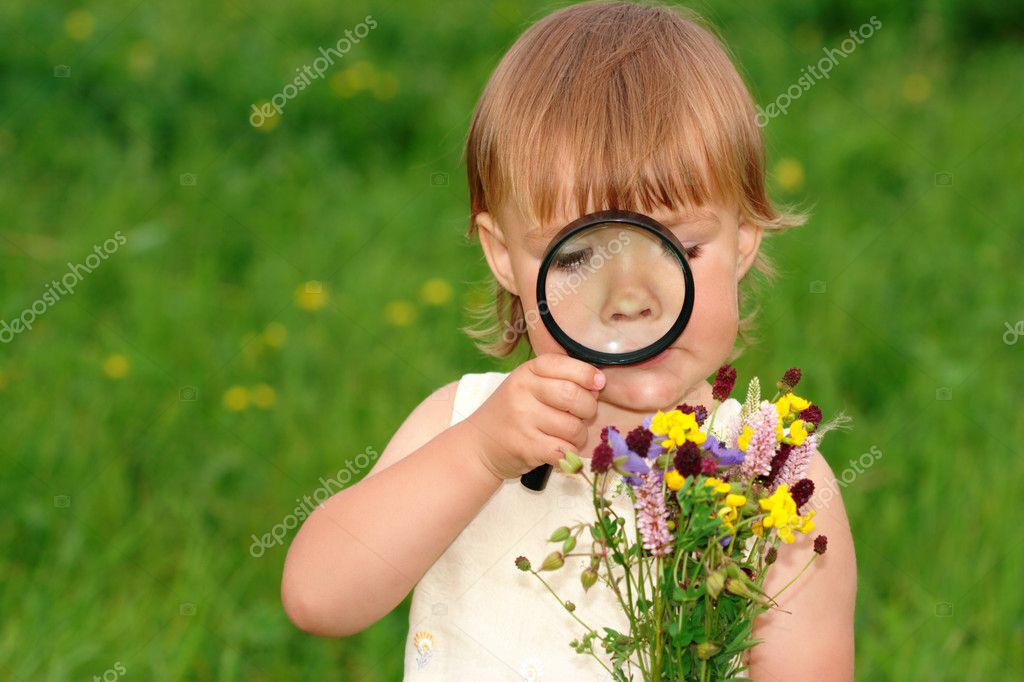 Child is looking at flowers