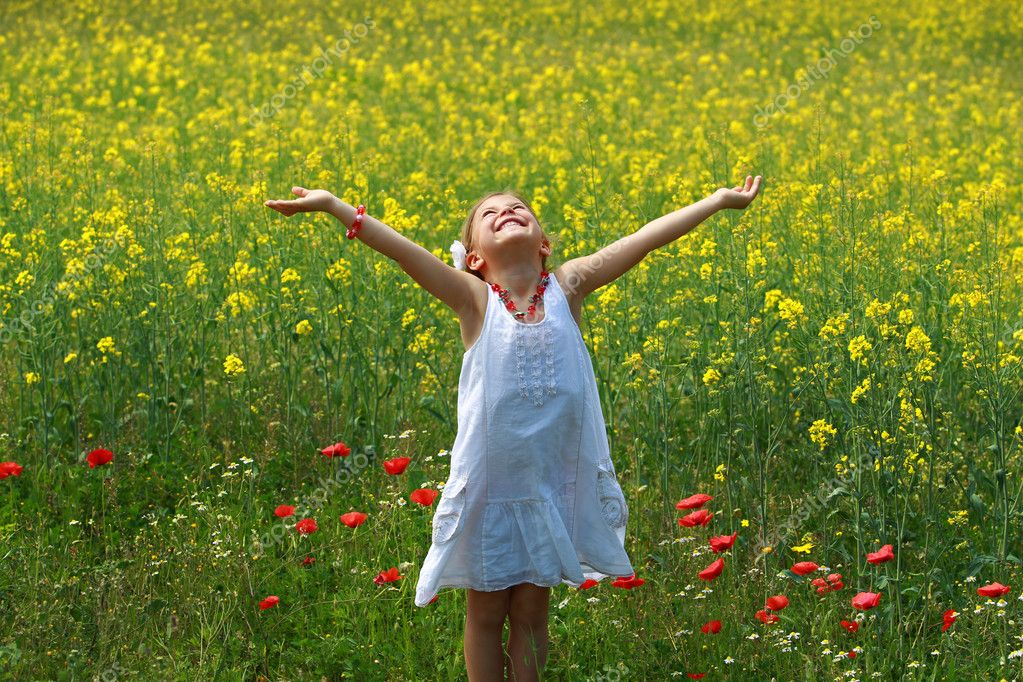 Girl surrounded by rapeseed flowers