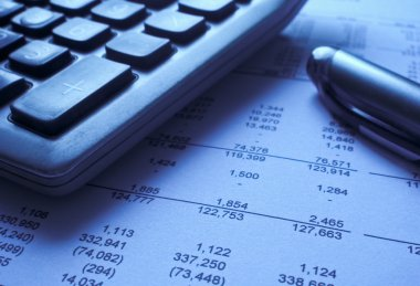 Financial statement, calculator and pen