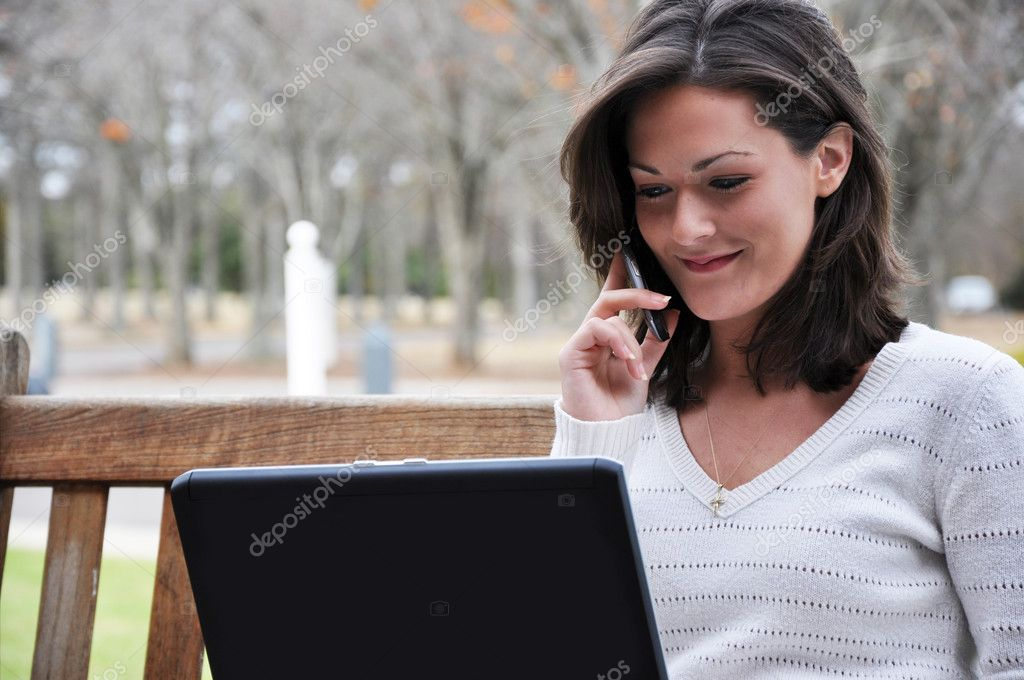 Female Student Using Computer Outside