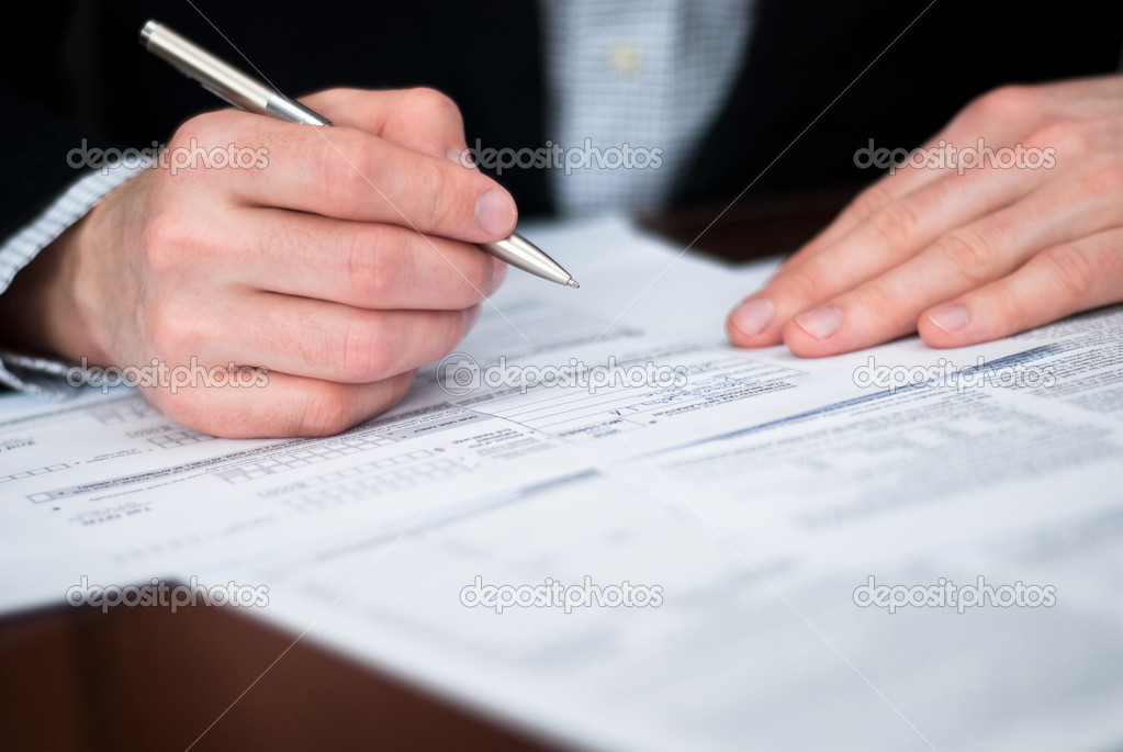 Filling out documents on a desk.