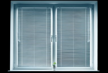 Window with blinds isolated on black.