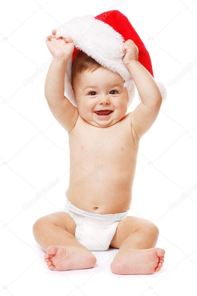 f50fbdbe1013b Sourire tout-petit jouant avec le chapeau du père Noël. isolé — Image de ...