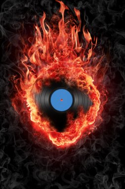 Burning vinyl record isolated over black background