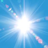 Fényképek nap sugarai ellen a kék ég