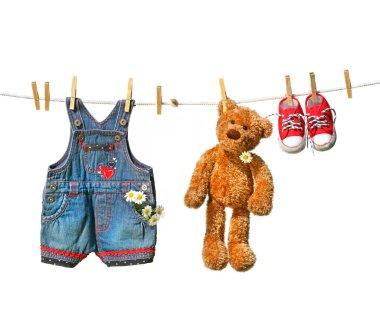Clothes with teddy bear on clothesline