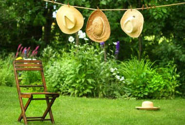 Straw hats on an old clothesline