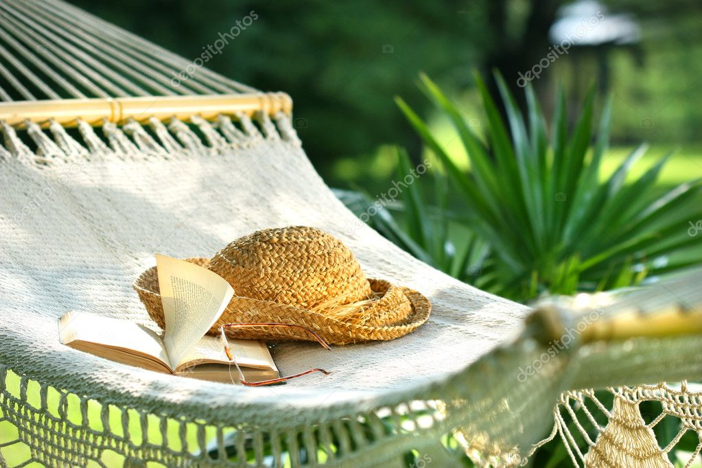 Hammock, book, hat, and glasses
