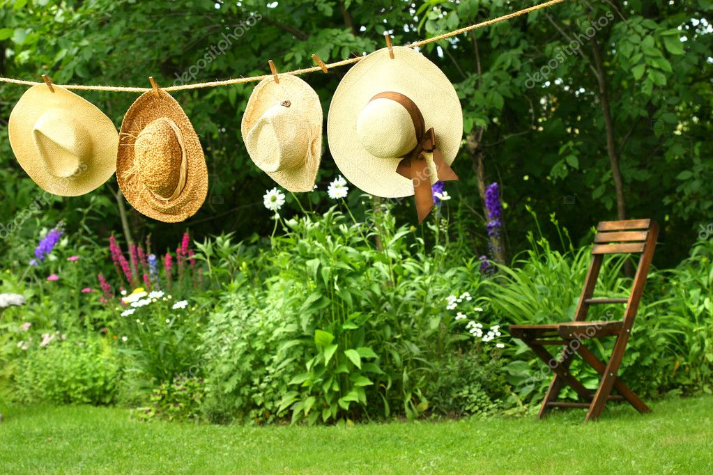 Summer straw hats hanging on clothesline