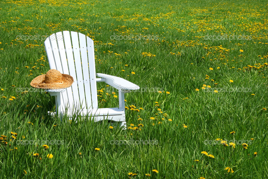 White chair with straw hat