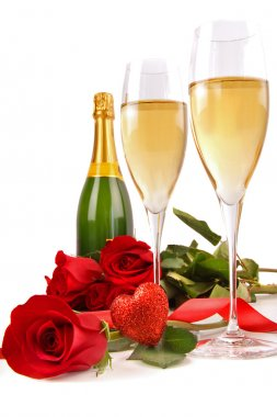 Champagne glasses with roses and little heart