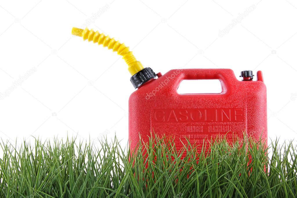 Plastic gas can in grass against white