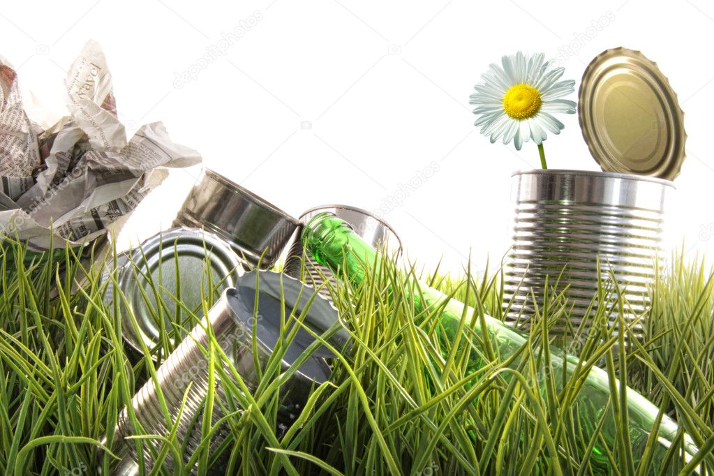 Trash, empty cans and bottles in grass