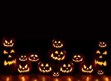 Lots of pumpkins lit brightly