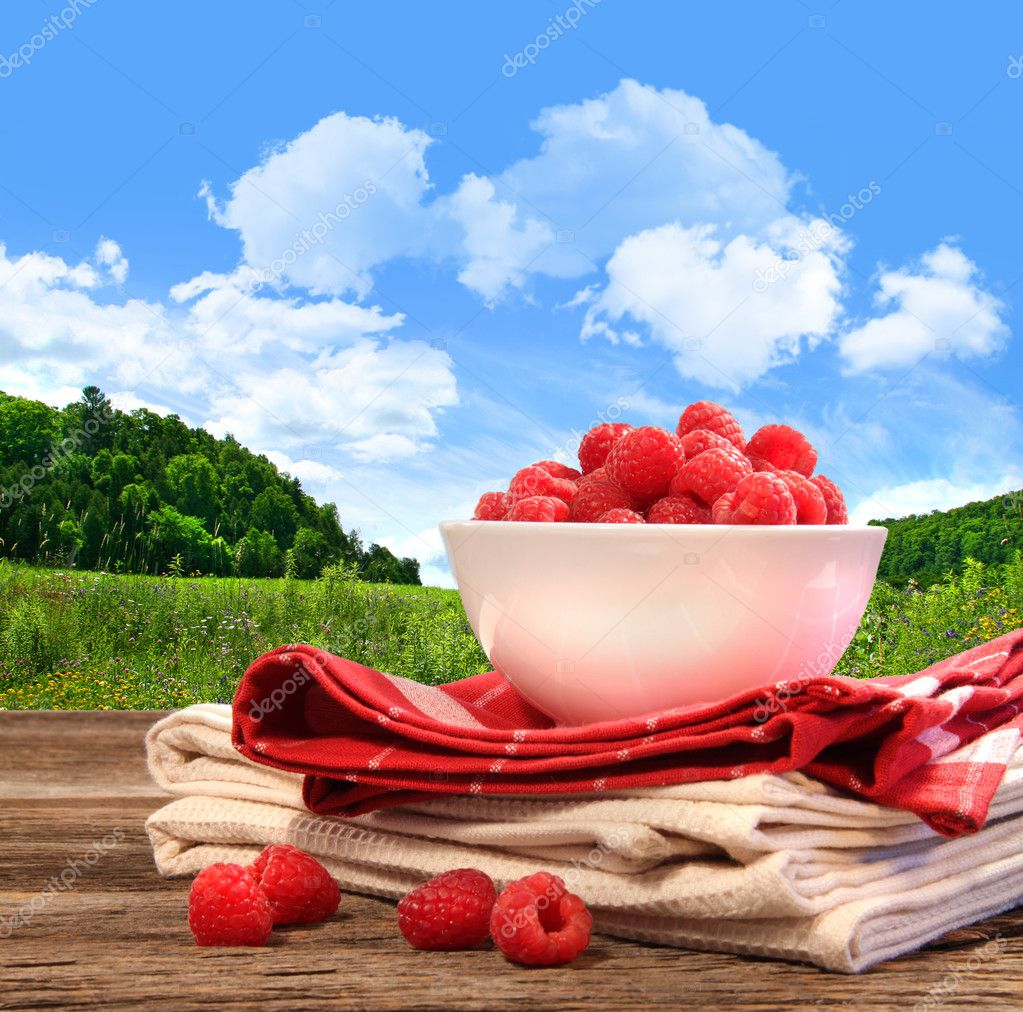 Bowl of raspberries on rustic table