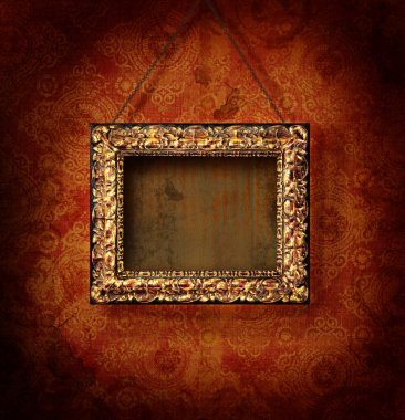 Golded picture frame on antique wallpaper