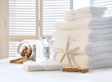 Fluffy white towels on table