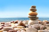 Fotografie Stack of pebble stones on white
